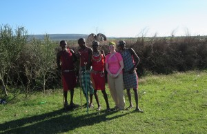 Posing in front of the village with some of our Maasai warrior hosts
