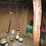 Kitchen and bed inside a Maasai enkaj