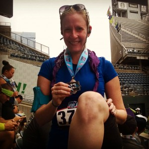 Showcasing my finisher's medal alongside my scarred, rebuilt knee. Triumph.