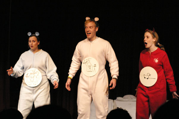 We didn't just do longform Scooby Doo - we also did shortform sendups of other cartoons. Here I am playing a nee Care Bear. In footie pajamas. Onstage. There is no glamour in improv.